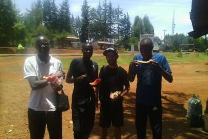 Jame and I in Iten Kenya having some watermelon with London 2012 Olympic 5000m bronze medallist.