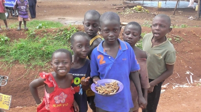 Some of the local kids (and a plate of chicken legs)
