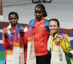 Irene Kosgei on the podium in Delhi (Gold medal)